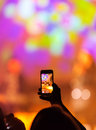 Concert recording video with a smartphone at a Royalty Free Stock Photography