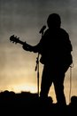 Concert stage and musician silhouette Royalty Free Stock Photo