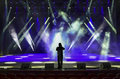 Concert stage singing man silhouette on a brightly lit Stock Images