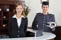 Concierge and receptionist in hotel happy waiting at counter Stock Photo