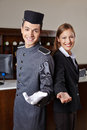 Concierge and receptionist in hotel offering welcome to guests Royalty Free Stock Photos