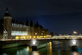 Conciergerie palace and pont au change in paris at night Royalty Free Stock Image