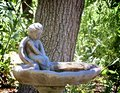 Angel concrete birdbath Royalty Free Stock Photo