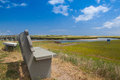 Concrete bench near the walkway to the dunes.Sandwich, Massachus Royalty Free Stock Photo
