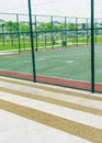 Concrete bench for spectators at futsal court Royalty Free Stock Photo