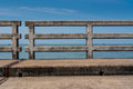 Concrete bridge railing show across the sea Royalty Free Stock Images
