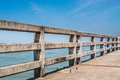 Concrete bridge railing show across the sea Royalty Free Stock Photo