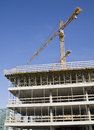 Concrete construction of administrative building being build in prague tower crane in the background Stock Images