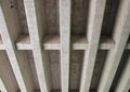 Concrete construction for highway bridge from beneath gray Royalty Free Stock Photo