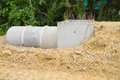Concrete drainage pipe and manhole under construction in thailand Royalty Free Stock Photo