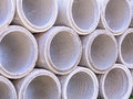 Concrete drainage pipes stacked on construction site Royalty Free Stock Image