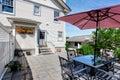 Concrete floor cozy patio area with table set and patio umbrella. Royalty Free Stock Photo