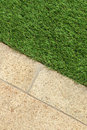 Concrete Floor and Green Artificial Grass landscaping design Royalty Free Stock Photo