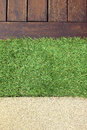 Concrete Floor Timber Decking and Green Artificial Grass Royalty Free Stock Photo