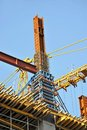 Concrete formwork and crane on construction site Stock Images