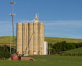 Concrete grain silos with cell phone tower Royalty Free Stock Photography