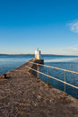 Concrete jetty and lighthouse Stock Image