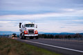 Concrete mixer classic big rig semi truck on evening road Royalty Free Stock Photo