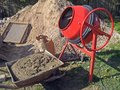 Concrete mixer mortable electric cement and wheelbarrow with cement mortar Stock Photo