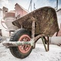 Concrete mixer old handcart and Stock Photography
