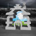 Concrete money symbols stacking building with billow Royalty Free Stock Photo