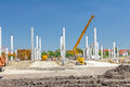 Concrete pillars of new edifice on sandy ground Royalty Free Stock Photo