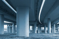 Concrete pillars of viaduct in monotone road curve and under the Stock Image