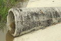 Concrete pipe for effluent discharge into the river Royalty Free Stock Photo