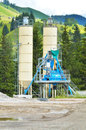 Concrete plant in the mountain manufacturing cement at Stock Photos