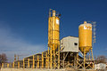 Concrete plant yellow silos of a factory against blue sky Royalty Free Stock Image