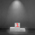 Concrete podium with number 1 on it and spot light Royalty Free Stock Photo