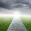 Concrete road in grass fields and rainclouds for one day Royalty Free Stock Photos