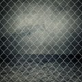 Concrete room obsolete gray grunge closed with chain link fence Stock Photo