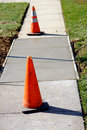 Concrete Sidewalk Repair on City Street with Cones Royalty Free Stock Photos
