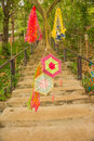 Concrete stairs to the sacred place on the mountian with decorations on the gate Royalty Free Stock Photos