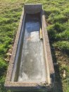 Concrete trough for farmyard animals Royalty Free Stock Photo