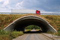 Concrete underpass under the highway road leading on a motorway passes truck Royalty Free Stock Photography