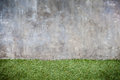 Concrete wall and green grass floor texture Royalty Free Stock Photo