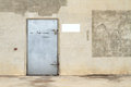 Concrete wall with metal door Stock Photos