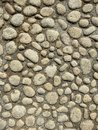 Concrete wall with pebbles Royalty Free Stock Photo