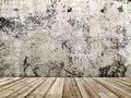 Concrete wall and wooden floor in a grunge style image Stock Photos