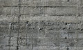 Concrete wall with wooden pattern impress from wooden form board shuttering and sags of cement Royalty Free Stock Photo