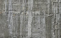 Concrete wall with wooden pattern impress from wooden form board shuttering and sags of cement Royalty Free Stock Photography