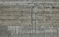 Concrete wall with wooden pattern impress from wooden form board shuttering and sags of cement Stock Image