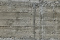Concrete wall with wooden pattern impress from wooden form board shuttering and sags of cement Royalty Free Stock Image