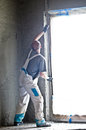 Concrete wall worker making a in new building or home Stock Images