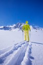 Concurring new snow land one man walking with ski over the to the mountain Royalty Free Stock Image