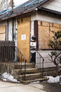 Condemned home foreclosure boarded up in Royalty Free Stock Images