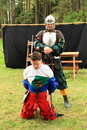 Condemned landsknecht man with a soldier behind that will make the execution during theatre performance at spring Stock Photography