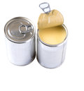 Condensed milk iii in tin cans over white background Stock Photo